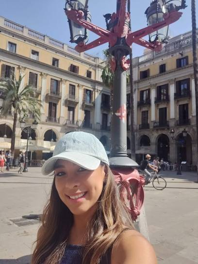 In front of the lamp post designed by Gaudí